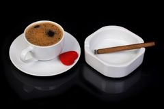 Coffee cup decorated with a bow and heart. Cigar and ashtray Stock Photography