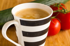 Coffee cup with delicious coffee, cucumber and tomatoes. Royalty Free Stock Photos