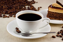 Coffee. Cup of coffee with a delicious dessertn Stock Images