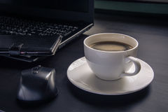 Coffee cup on the desk.  royalty free stock images