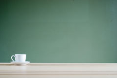 Coffee cup on desk Stock Photo