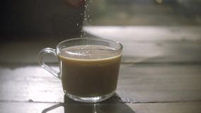 Coffee cup detail and teaspoon. Pouring sugar on coffee cup. stock video footage