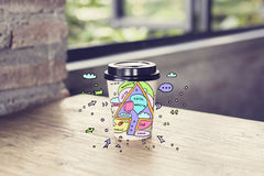 Coffee cup with digital marketing sketch. Take away coffee cup with creative digital marketing sketch on wooden table Stock Photo