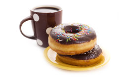 Coffee cup and donut Stock Image
