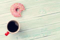 Coffee cup and donut Stock Images
