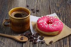 Coffee cup and donut Stock Photos
