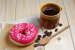 Coffee cup and donut Stock Photography