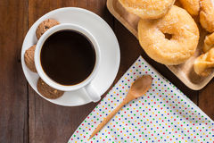 Coffee cup, donuts, cookie on wooden background, top view Royalty Free Stock Image