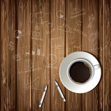 Coffee cup and drawing business strategy plan. Concept idea on wooden table. Workflow layout Royalty Free Stock Image
