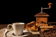 Coffee cup, dried orange fruit, cinnamon sticks and coffee grind Royalty Free Stock Images