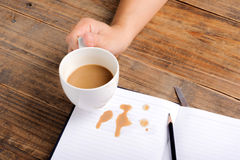 Coffee in cup drop on the white page Royalty Free Stock Photography