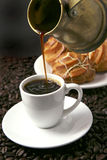 Coffee cup and eclairs Royalty Free Stock Images