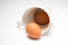 Coffee cup with eggs Stock Images