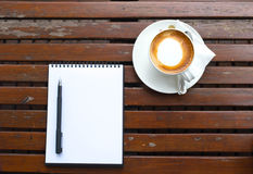 Coffee of cup and empty notepad. Background Stock Photos