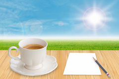 Coffee cup and empty paper Stock Images