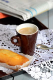 Coffee cup espresso with cake and newspaper Stock Images