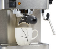 Coffee cup with espresso maker machine Stock Images