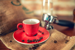 Coffee cup with espresso in pub with temper, coffee beans and portafilter. Vintage effect Royalty Free Stock Photography