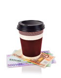 Coffee cup and euro banknotes Stock Image