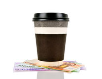 Coffee cup and euro. Green disposable coffee cup and euro banknotes Royalty Free Stock Image