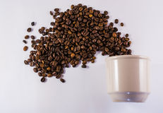 Coffee Cup and Exploding Roasted Beans Royalty Free Stock Photos