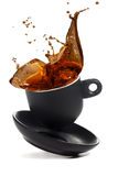 Coffee cup falls on the white surface Royalty Free Stock Photo