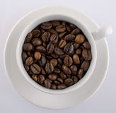 Coffee cup filled with coffee beans Royalty Free Stock Photography