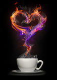Coffee cup with a fire heart. Coffee cup and heart symbol made of fire flame Royalty Free Stock Photos