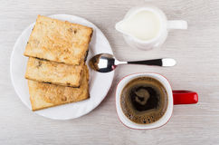 Coffee cup, flaky cookies and milk jug on wooden table Stock Photos