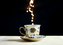 Coffee cup on flare lights background Stock Image