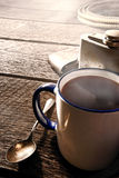 Coffee Cup and Flask with Cowboy Gear in a Ranch Royalty Free Stock Photography