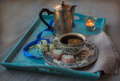 Coffee cup with flower and burning candle Royalty Free Stock Images
