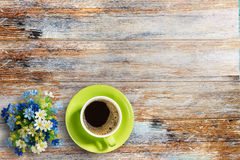 Coffee cup and flower on old wooden table background Royalty Free Stock Images
