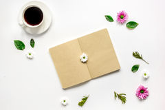 Coffee cup with flower petals and notebook top view mock-up Stock Image