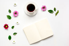 Coffee cup with flower petals and notebook top view mock-up Stock Photo