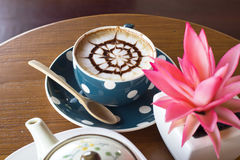 Coffee cup and flower Stock Images