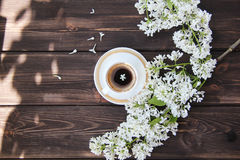 Coffee Cup and flowers of dandelions. On a wooden table Royalty Free Stock Image