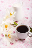 Coffee cup and flowers Stock Image