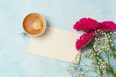 Coffee cup, flowers and paper note. View from above. Flat lay Royalty Free Stock Photography