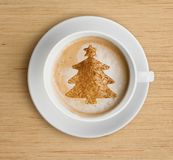 Coffee cup with foam and christmas tree shape stock photos