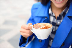 Coffee cup with foam shape - cafe woman drinking Stock Image