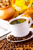 Coffee cup with fresh coffe beans Royalty Free Stock Photo