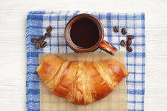 Coffee cup and fresh croissant Royalty Free Stock Image