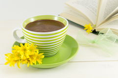 Coffee cup with fresh flowers and a book Royalty Free Stock Photo
