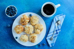 Coffee cup and freshly pastries with blueberry Stock Photos