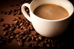 Coffee cup in front of dark background Stock Photography
