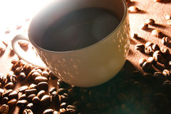 Coffee cup in front of dark background Royalty Free Stock Images