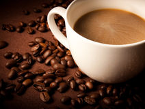Coffee cup in front of dark background Stock Image
