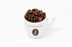 Coffee cup full of beans Stock Image