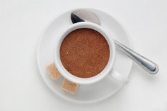 Coffee cup full of ground coffee against white background, top view with space for text Royalty Free Stock Photos